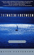 The Water in Between: A Journey at Sea Cover