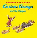 Curious George and the Puppies Cover