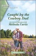 Caught by the Cowboy Dad: A Clean Romance