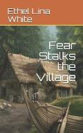 Fear Stalks the Village